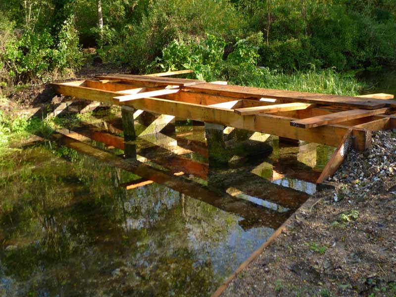 Wooden bridge during construction.